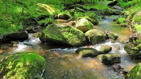 River runs over boulders stock footage