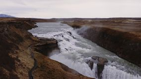 River runs in toSeljalandsfoss waterfall, Iceland stock footage