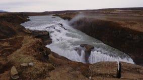 River runs in toSeljalandsfoss watfall, Iceland. View of Seljalandsfoss watfall in Iceland stock video footage