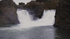 River runs in toSeljalandsfoss watfall, Iceland. View of Seljalandsfoss watfall in Iceland stock video