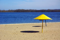 River's beach. Two beach umbrellas Stock Image