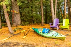 At the river`s edge a kayak with life jacket and paddle with two royalty free stock images