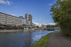 The River In Saarbrucken, Germany. The Saar Center On The River Banks In Saarbrucken, Germany In The  Summer 2017 Royalty Free Stock Photo