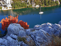 River sailing. Yacht on a bright blue river in Croatia Stock Images