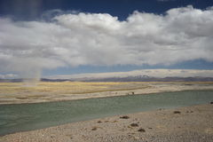 River and sand storm in Tibet Royalty Free Stock Photography
