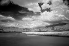 River Scene with Dramatic Clouds Royalty Free Stock Images