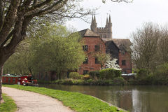River scene with narrow boat & house. Canal with narrow boat,towpath and house Royalty Free Stock Images