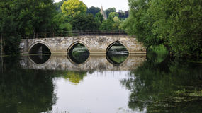 River Scene with an Old Stone Bridge. Historic Stone Bridge over the River Avon in Bradford on Avon in Wiltshire England Royalty Free Stock Photos