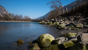 River scene. A peaceful view of the river flowing throughout the austrian alps Royalty Free Stock Photo