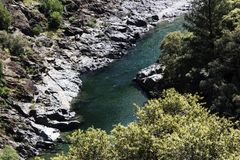 River Seen From Above Rocky Shore And Trees Stock Photo
