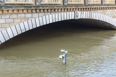 River Seine Flooding in Paris. Paris,France - June 05, 2016: Surveillance cameras on the top of a pole are almost covered by water on the River Seine embankment Royalty Free Stock Photo