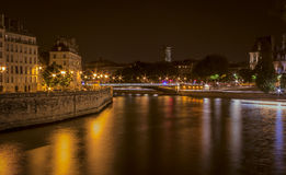 The River Seine at night along the Right Bank. And Ile de la Cite from western tip of  Ile de St. Louis Royalty Free Stock Images