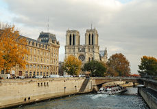River Seine Paris. With Notre Dame cathedral in the background Stock Photos