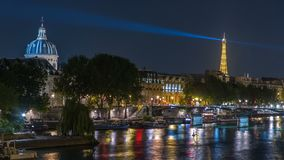 River Seine with Pont des Arts and Institut de France at night timelapse in Paris, France.