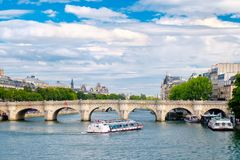 The river Seine and the Pont Neuf in Paris on a summer day Stock Photos