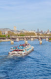 River Seine and touristic Boat, Paris Royalty Free Stock Photo