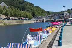 River Semois with pedalos for recreation in Bouillon, Belgium. BOUILLON, BELGIUM - AUG 13: Belgian river Semois with pedalos for recreation on August 13, 2016 in royalty free stock photography