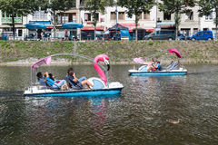 River Semois with people relaxing in pedalo in Bouillon, Belgium Royalty Free Stock Image