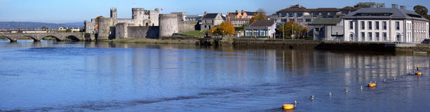 River Shannon Limerick. Thomand Bridge, King John's Castle and Limerick City Courthouse on the side of the river Shannon, Limerick Ireland Stock Photo