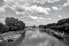 River, ships and bridge in Paris, France on natural background. Green water and trees on cloudy blue sky. Landmark and tourist destination. Summer vacation and Royalty Free Stock Photo