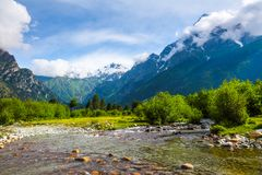 From the river shore opens view on fantastic glacier. Stock Photo