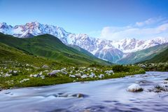 From the river shore opens view on fantastic glacier. Stock Photos