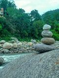 River side. Balanced stone at River side feeling refreshed royalty free stock image
