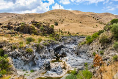 The river Simeto, in Sicily. The river Simeto passes through an ancient solidified lava flow of volcano Etna Royalty Free Stock Image