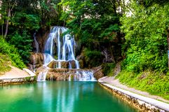 Beautiful waterfall in Slovakia. The river is a slice of mellow harmony amid the fragrant leaves Royalty Free Stock Photos
