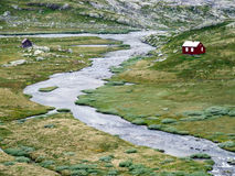 River and small houses in Norway. Lonely houses by the river in Norway Stock Photography