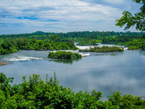 A river with small rapids. Flowing in Uganda Royalty Free Stock Image