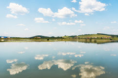 The river, small village behind it and blue sky with clouds, ref Royalty Free Stock Photos