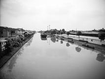 A river through a small village Stock Photography