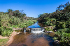 River Small Weir Vegatation Royalty Free Stock Photography