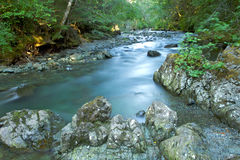 River with Smooth flowing water. River rocks with Smooth flowing water Stock Photos