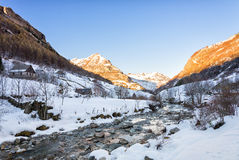 River and snow in the cirque of Gavarnie Stock Photo
