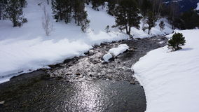 River in with snow. River in the middle of a mountain with snow Stock Photo