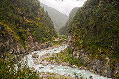 River and snow mountains in Nepal Himalayas Stock Photo