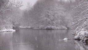 River in Snowstorm stock footage