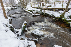River in snowy countryside Stock Images