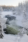 A river on a snowy landscape royalty free stock images