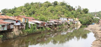 River in Sorong. River with poor houses on bank in Sorong (Papua Barat, Indonesia Stock Photography
