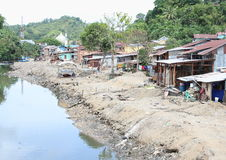 River in Sorong. River with poor houses on bank in Sorong (Papua Barat, Indonesia Royalty Free Stock Images