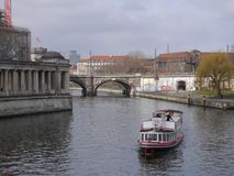 River Spree in Berlin, and the Bode Museum. A pleasure boat is passing by stock image