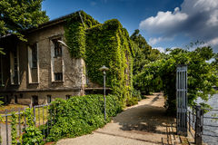 River Spree Embankment and House with Grape Vines, Berlin Stock Photo