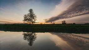 River in spring at dawn. Reflection of clouds in water stock video footage