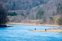 River at spring time. People fishing Royalty Free Stock Photos