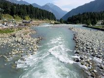 River in Srinagar Kashmir. River mountains forests sunny day Kashmir jeelam india Stock Photography