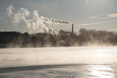 River Steam and Pollution Smokestack Royalty Free Stock Photo