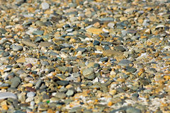 River stones texture. River gray and beige color pebbles texture Royalty Free Stock Photography